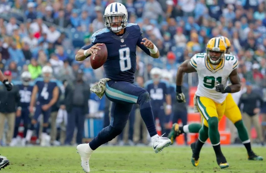 Titans QB Marcus Mariota scrambles for a first down against the Packers