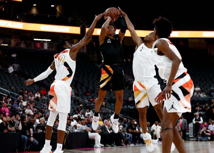 Boogie Ellis attempts a jump shot over two defenders at the Jordan Brand Classic.