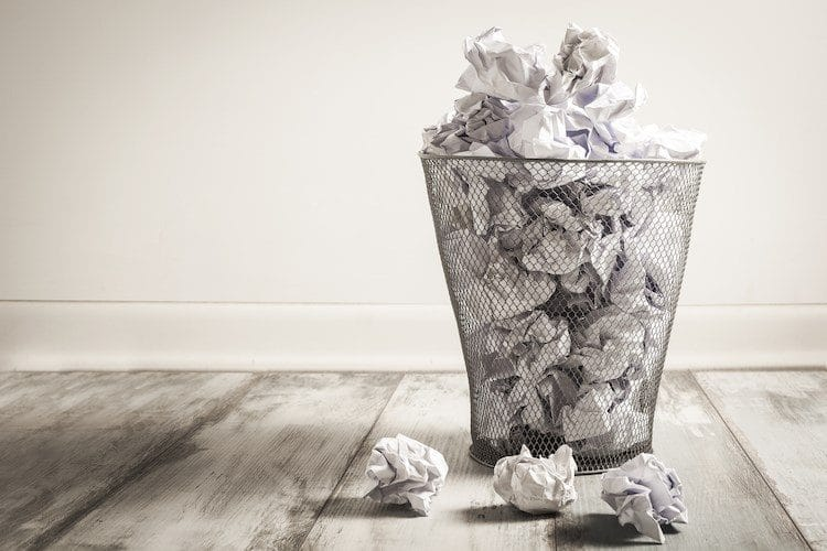 Trash can with paper