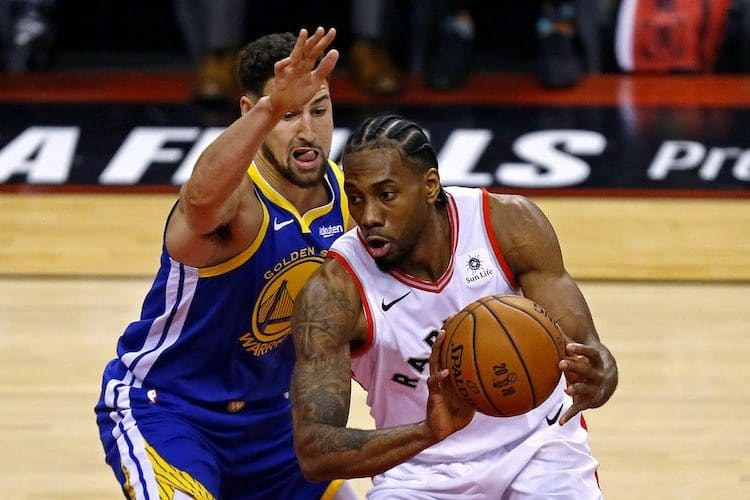 Raptors forward Kawhi Leonard (2) handles the ball against Golden State Warriors guard Klay Thompson (11) during the first quarter in game one of the 2019 NBA Finals at Scotiabank Arena ( John E. Sokolowski-USA TODAY Sports)