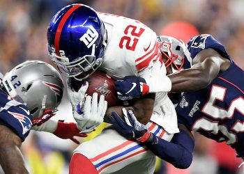 Patriots defensive backs Keion Crossen (35) and Malik Gant (42) tackle Giants running back Wayne Gallman (22) during the second half at Gillette Stadium. (USA Today Images)