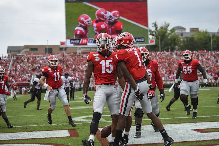 Sep 14, 2019; Athens, GA, USA; Georgia Bulldogs wide receiver Lawrence Cager (15) reacts with teammates after catching a touchdown pass against the Arkansas State Red Wolves during the first half at Sanford Stadium. Mandatory Credit: Dale Zanine-USA TODAY Sports