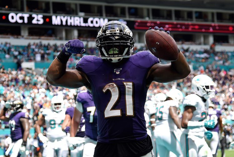 Baltimore Ravens running back Mark Ingram (21) celebrates his touchdown run against the Miami Dolphins during the first half at Hard Rock Stadium. Mandatory Credit: Steve Mitchell-USA TODAY Sports