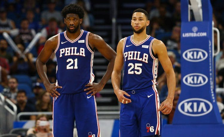 Oct 13, 2019; Orlando, FL, USA; Philadelphia 76ers center Joel Embiid (21) and guard Ben Simmons (25) during the second quarter at Amway Center. Mandatory Credit: Kim Klement-USA TODAY Sports