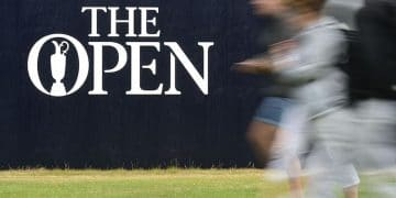Multiple exposure image of fans walking near a logo during a practice round of The Open Championship  (USAT)