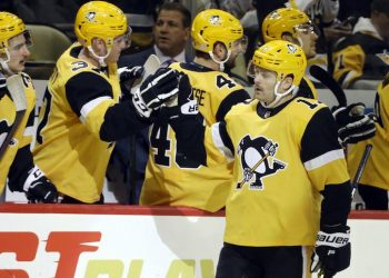 Nov 16, 2019; Pittsburgh, PA, USA;  Pittsburgh Penguins right wing Bryan Rust (17) celebrates his goal with the bench against the Toronto Maple Leafs during the third period at PPG PAINTS Arena. Pittsburgh won 6-1. Mandatory Credit: Charles LeClaire-USA TODAY Sports