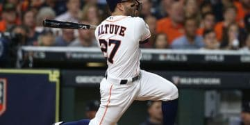 Oct 19, 2019; Houston, TX, USA; Houston Astros second baseman Jose Altuve (27) hits a double during the first inning against the New York Yankees in game six of the 2019 ALCS playoff baseball series at Minute Maid Park. Mandatory Credit: Troy Taormina-USA TODAY Sports