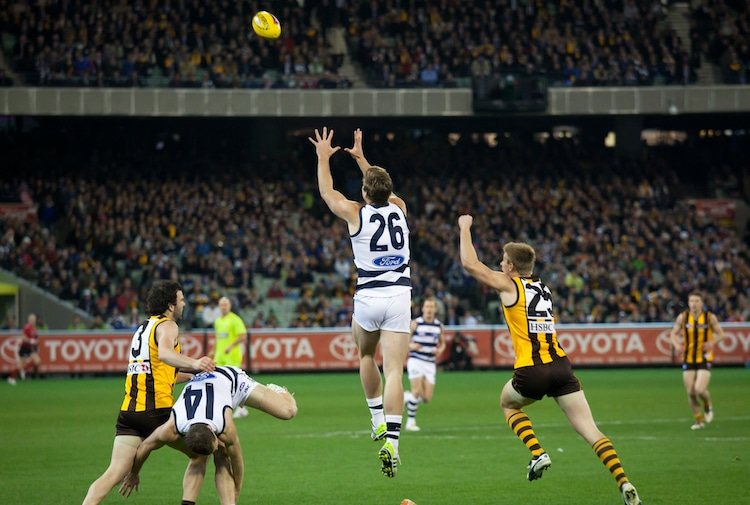Tom Hawkins(C) leaps for a mark during Geelong's win over Hawthorn - September 9, 2011 in Melbourne, Australia.