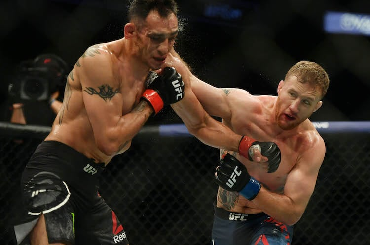 May 9, 2020; Jacksonville, Florida, USA; Tony Ferguson (red gloves) fights Justin Gaethje (blue gloves) during UFC 249 at VyStar Veterans Memorial Arena. Mandatory Credit: Jasen Vinlove-USA TODAY Sports