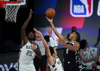 Aug 4, 2020; Nets guard Timothe Luwawu-Cabarrot shoots over Bucks' Marvin Williams (Credit: Ashley Landis/Pool Photo via USA TODAY Sports)
