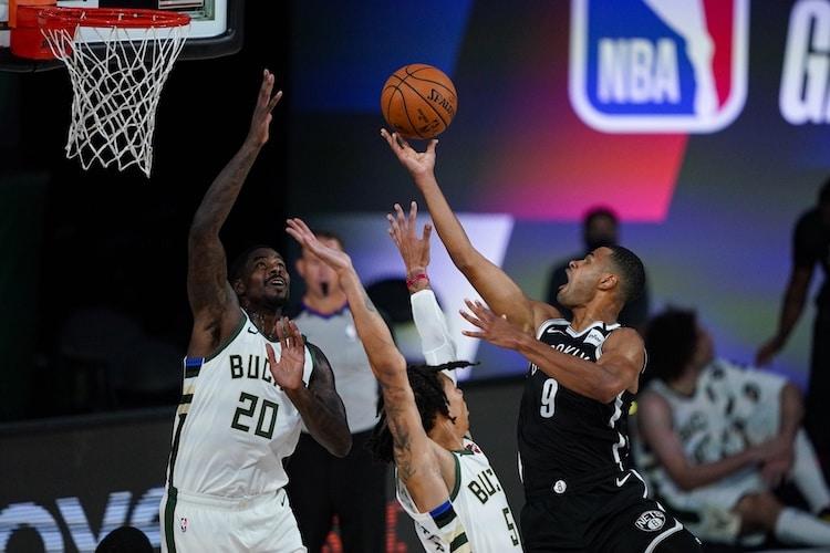 Aug 4, 2020; Nets guard Timothe Luwawu-Cabarrot shoots over Bucks' Marvin Williams (Credit: Ashley Landis/Pool Photo via USA TODAY Sports)